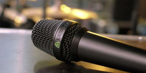 This image shows the MTP 840 DM live performance microphone on stage