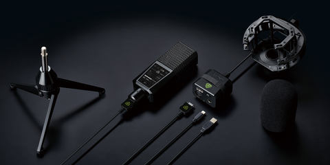 This image shows the DGT 650 USB microphone and interface on black background