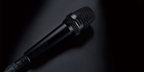 This image shows the MTP 550 DM live performance microphone on black background