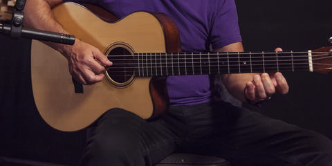 This image shows a LCT 140 small diaphragm condenser microphone on a Martin acoustic guitar