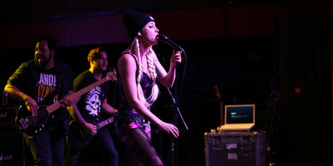 Christina Chriss of Kaleido with her go-to mic the MTP 550 DM live performance microphone