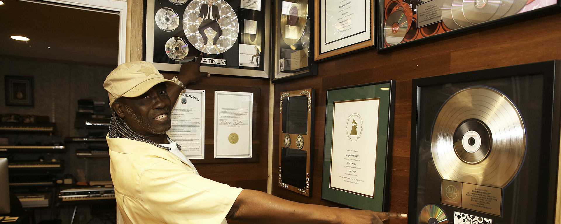 Benjamin Wright showing his Gold and Platinum Records
